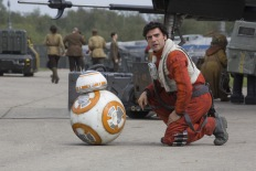 BB-8 and Poe Dameron (Oscar Isaac)..Ph: David James..? 2015 Lucasfilm Ltd. & TM. All Right Reserved.