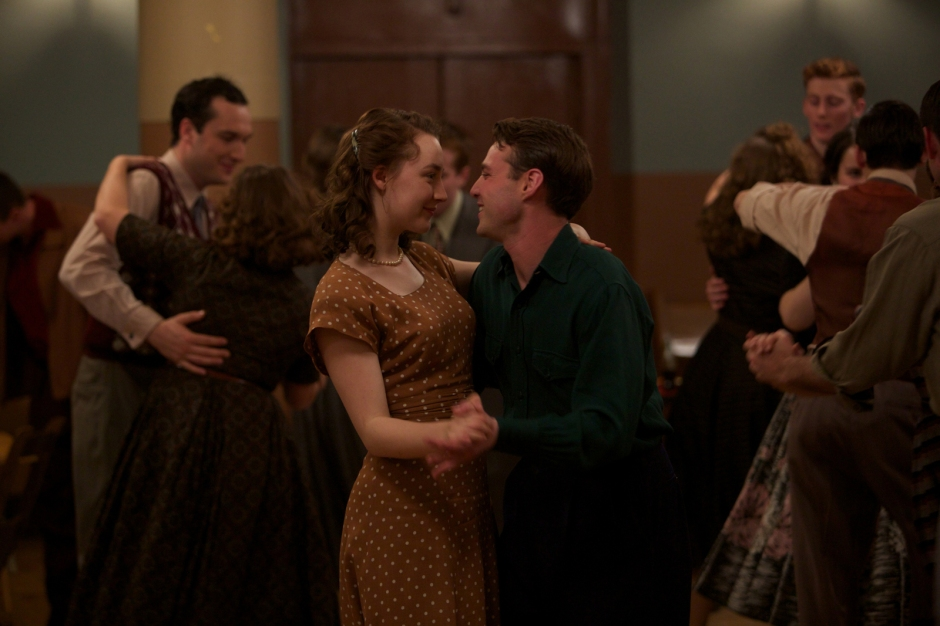 """Saoirse Ronan as """"Eilis"""" and Emory Cohen as """"Tony"""" in BROOKLYN. Photo by Kerry Brown.  © 2015 Twentieth Century Fox Film Corporation All Rights Reserved"""