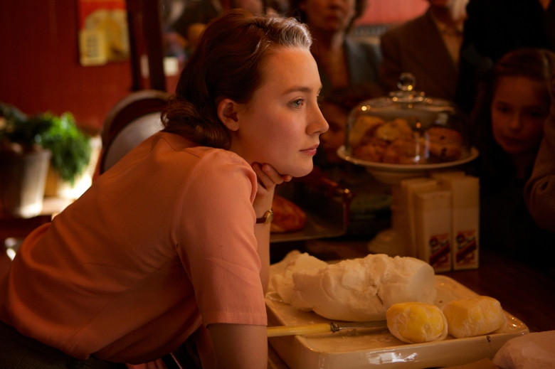 """Saoirse Ronan as """"Eilis"""" in BROOKLYN. Photo by Kerry Brown. © 2015 Twentieth Century Fox Film Corporation All Rights Reserved"""