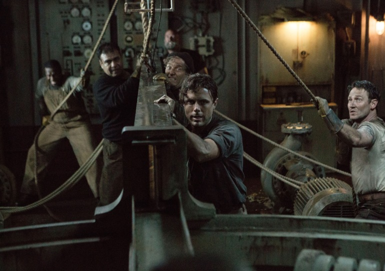 Ray Sybert (Casey Affleck) and Tchuda Southerland (Josh Stewart) struggle to keep their ship, the SS Pendleton, from sinking in Disney's THE FINEST HOURS.